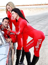Hot race car babes fucked by the race car driver in these hot real on track sex pics