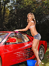 Hot Blonde Soaping Up A Red Ferrari