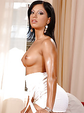 Brunette show off her tanned body