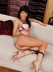 Black-haired babe Ema stripteasing