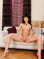 Black-haired babe Ema stripteasing