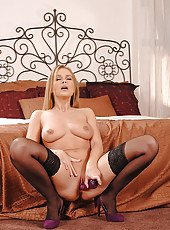 Sexy blonde Colette toying pussy