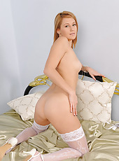 Blonde Adriana getting naked on bed