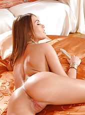 Busty Nelly Sullivan toying on bed
