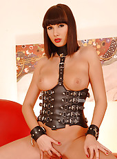 Horny babe in leather being naughty