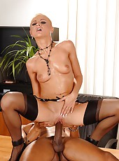 Horny secretary riding a dark shaft