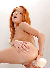 Kinky redhead Nataly toying her ass