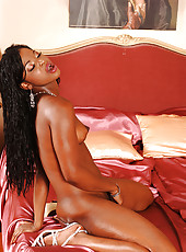 Slim black babe fingering her pussy