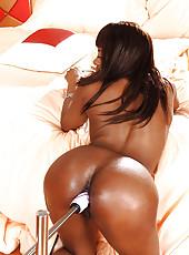 Ebony babe rides fucking machine