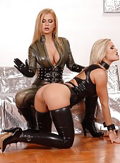 Strap-on PVC lesbian babes have sex