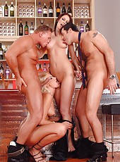 Two hot babes have group sex in bar
