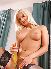 Hot blonde babe enjoys a big dildo