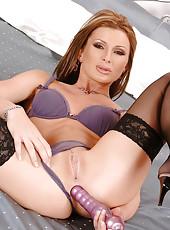 Electra enjoys dildoing her ass