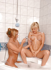 Lesbian babes in bathroom action