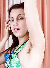 Vesta sparkles as a sexy Ukrainian beauty. She lifts her green floral dress and shows off her sexy young hairy pussy. She is so sexy, and she has her favorite glass dildo that she masturbates with too.