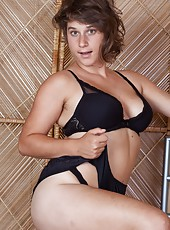 Sayge looks incredible in her lingerie outfit. She plays in bed and dances on the bed in her lingerie. She strips naked and fingers her hairy pussy and all natural body, and is a sexy vision in bed.