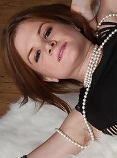 Zia slowly strips out of her black dress, pearls, and fishnet stockings. As she does, she shows off her hairy pussy from behind, petite breast, hairy pits, and she masturbates her hairy beaver.
