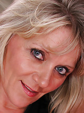 Horny 48 year old Sherri Donovan probes her pussy with plastic