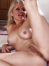 Horny blonde Sherri Donovan pulling her mature ass cheeks apart
