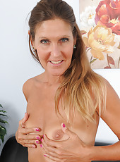 Athletic and blonde mature LA Valkenburg tugs at her short pubes