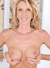 Hot blonde 45 year old Brynn Hunter slips out of her undies in here