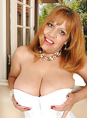 47 year old Marissa pops her huge boobs out of her white lingerie