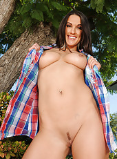 Tight bodied Misty Anderson shows off her long legs in the backyard