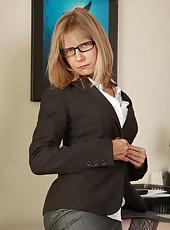 Horny blonde secretary Lexa Mayfair pulls open her box on the desk