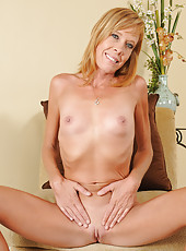 Petite 36 year old Stacy Y yanks off her lingerie and spreads pussy