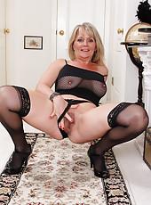 Naughty blonde 48 year old Sherri Donovan in fishnet lingerie posing