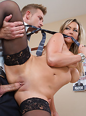 Abbey Brooks catches her boss with his pants down so she takes advantage and sucks his cock before getting fucked.