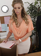 Gorgeous blonde is horny and wants to fuck her boss on his desk.