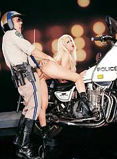 Slut fucks cop on bike.