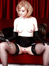 Nina Hartley strips black lingerie