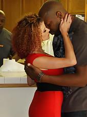 Sexy redhead milf Joslyn James in stockings fucking with black guy