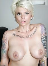 Tattoed blonde mom Monroe Valentino in hot interracial sex scene