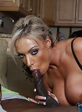 Sexy big titty pornstar Carmen Jay sucking huge black cock on sofa