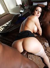 Hot brunette milf Gianna Foxxx service two big black cocks
