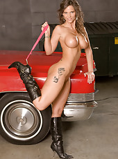Hot milf Syren Demer in red sexy lingerie posing by a car