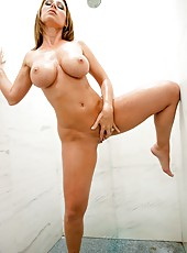 Sexy warden Devon Lee undresses her clothes and masturbates in the bathroom