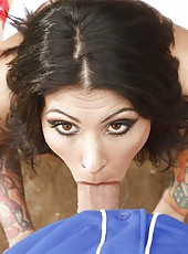 Tattooed brunette with sexy brown eyes Ricki Raxxx enjoys only hard bats and big cocks