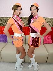 Two gorgeous lesbians Kortney Kane and Nikki Monroe taking off sexy uniform