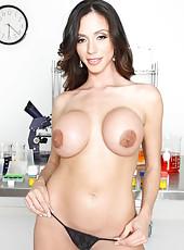 Brunette mistress Ariella Ferrera surprises us with her big round boobs in the laboratory