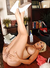 Sumptuous blonde housewife Bridgette B wipes dust from her shaved pussy