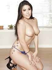 Appetizing Asian brunette London Keyes takes off her uniform and amazes