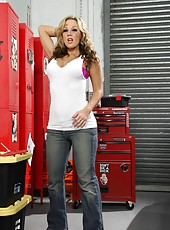 Really hot milf with big breast Nikki Sexx strips in the garage