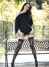 Black haired babe in sexy stockings Cassidey spreads her long legs on the camera