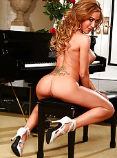 Stunning and buxom bombshell Capri Cavanni presents her delicious pussy