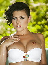 Brunette hottie with big tits and sexy tattoo Eva Angelina poses outdoor