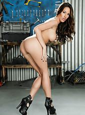 Amazing brunette model with big round boobs Kortney Kane poses in the garage